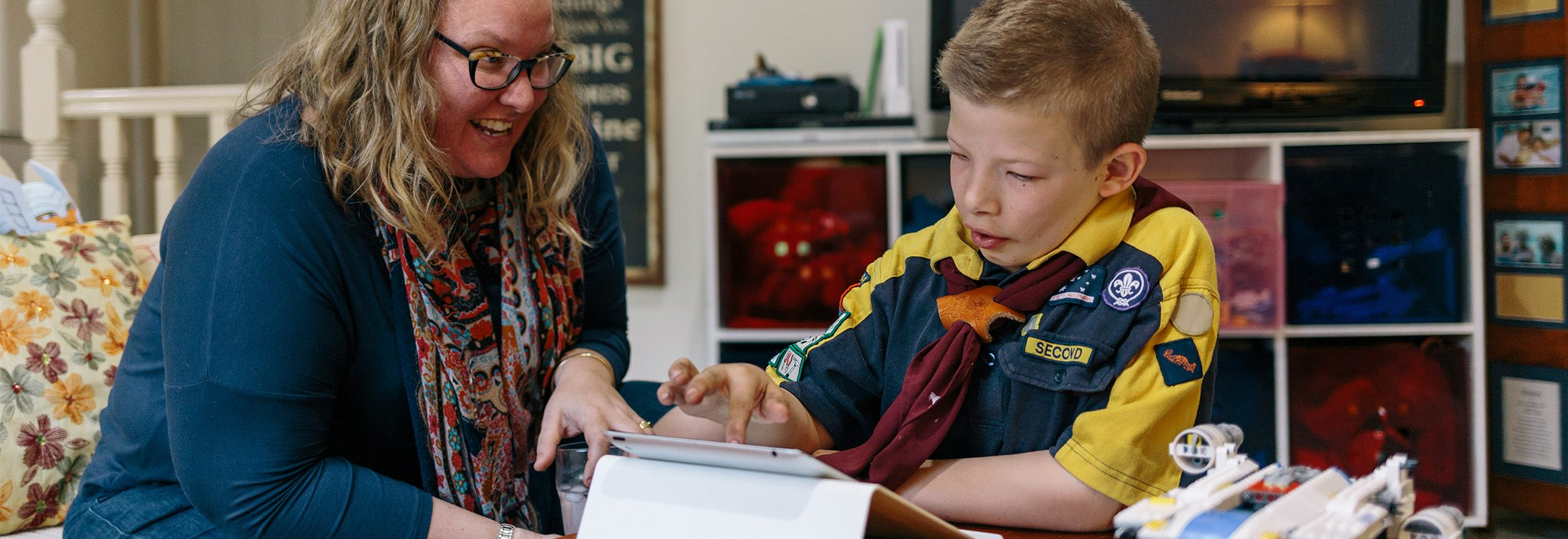 Boy and teacher using iPad