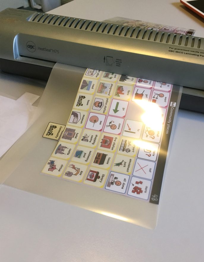 Laminating page AAC book