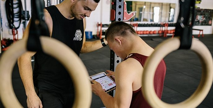 Tom using Proloquo2Go at the gym