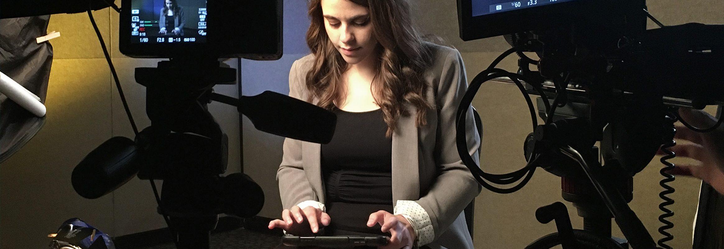 Girl typing on an iPad