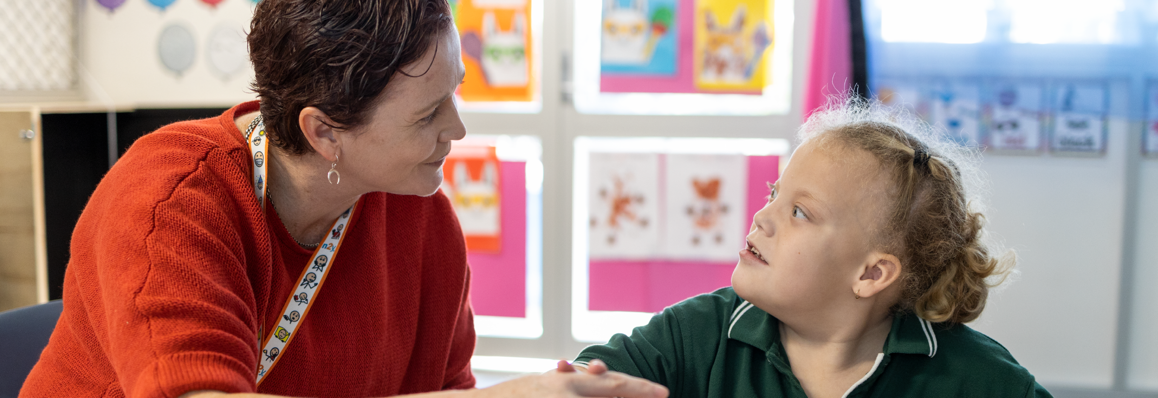 Communication partner speaking with an AAC user