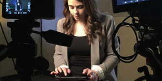 Girl typing on an iPad