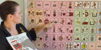 Teacher pointing to picture word chart