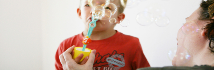 Young boy getting help for speech impediment with bubbles