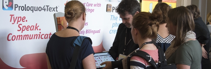AssistiveWare's stand on the Communication Matters International AAC Conference with David Niemeijer showing Proloquo2Go, AssistiveWare's symbol based text to speech app, to an attentive audience.