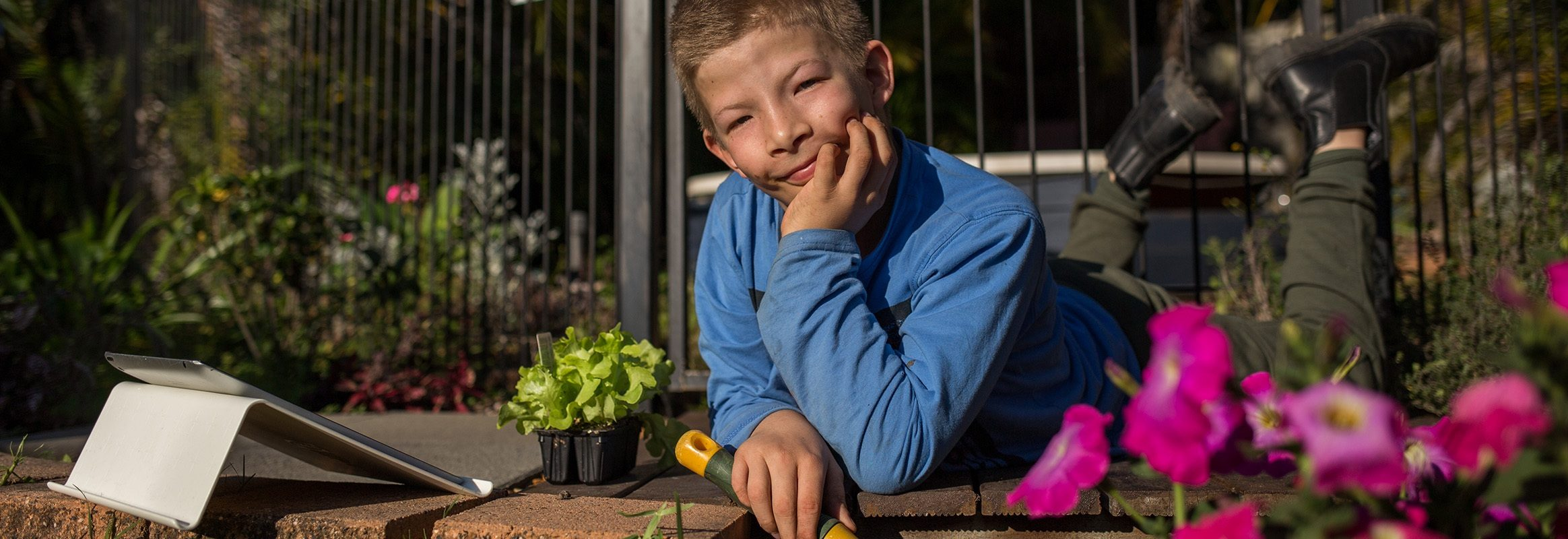 Boy in garden contemplating