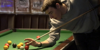 Ben plays pool with a mate