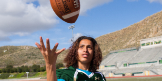 Teen boy playing football